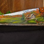 Fall Log Cabin with Deer Handsaw
