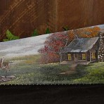 Fall Log Cabin with Running Deer Handsaw